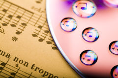 Music on disc. Music, water drops and reflections of notes on disc Royalty Free Stock Photography
