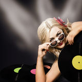 Music DJ girl holding audio vinyl record Royalty Free Stock Images