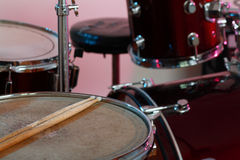 Music drums instrument. Close up with  drumsticks on the top royalty free stock photography