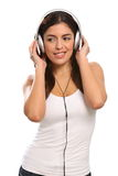 Music in the ears of young girl wearing headphones Stock Image