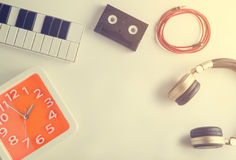 Music entertainment equipments with orange clock. Vintage tone Royalty Free Stock Images