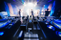 Music equipment DJ in nightclub closeup with blurred background dancing people Royalty Free Stock Photography