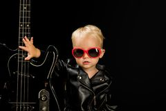 Music for everyone. Adorable small music fan. Small musician. Little rock star. Child boy with guitar. Little guitarist royalty free stock photos