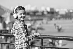 Music everywhere you go. Child listen music outdoors modern headphones. Kid little girl listen song headphones. Music royalty free stock images