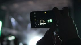 Music fan choosing suitable filter for filming concert video in good quality. Stock footage stock video footage
