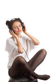 Music fan girl in headphones Stock Photography