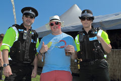 Music Fan with Police Royalty Free Stock Photography