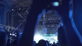 Music fan recording video at concert, saving memories with happy moments. Stock footage stock video