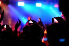 Music fans with phones Royalty Free Stock Images