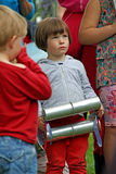 Music festival boy. Photo of a young boy playing a musical instrument at the samba pelo mar drumming band at whitstable castle grounds on 25th may 2015 Stock Photography