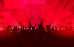 Music festival with dancing people and glowing lights. Royalty Free Stock Image