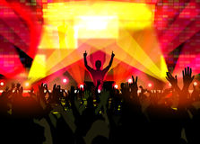 Music festival with dancing people and glowing lights. Electronic dance music festival with silhouettes of happy dancing people with raised up hands. Creative Stock Photo