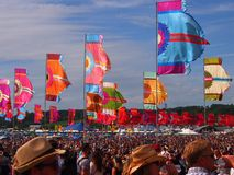 Music Festival flags and crowd Stock Photo