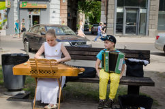 Music festival girl baltic psaltery boy accordion. VILNIUS, LITHUANIA - MAY 18: young street music festival participants girl with baltic psaltery and boy with Stock Photography