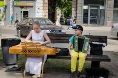 Music festival girl baltic psaltery boy accordion Stock Photography