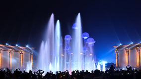 Music fountain lighting show club party entertainment. Magic lighting show party ,cheerily crowd  near the colorful music fountain,China,Asia Royalty Free Stock Photos