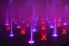 Music fountain singing fountain. Musical fountain closeup at night ,colorful fountain with modern led lamps.colorful water Royalty Free Stock Photos