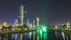 Music fountains in park with Kuwait City cityscape night timelapse hyperlapse stock video