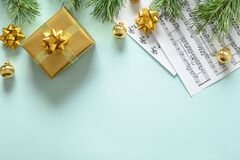 Free Music Frame For Christmas Carols And Sings Decorated Golden Balls On Blue. Stock Photo - 204227570