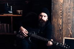 Music is fun. Hipster musician. Bearded man play the guitar. Rock guitarist playing music. Rock style man. Rock and roll. Music performer. Electric guitar stock photo
