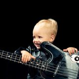 Music is fun. Small musician. Little rock star. Child boy with guitar. Little guitarist in rocker jacket. Rock style. Child. Rock and roll music performer stock photo