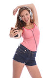 Music fun for teenage girl singing with headphones Stock Images