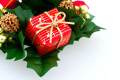 Music gift box. Red christmas gift box coloseup wrap in red papaer with musical symbols and golden ribbon Stock Images