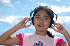 Music Girl. Girl listening to and singing music Stock Photo