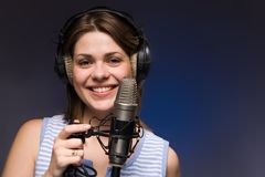 Music girl. Girl with old grey  microphone Royalty Free Stock Photo