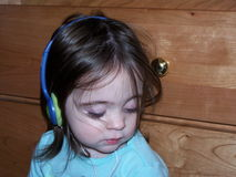 Music Girl. A little girl with headphones on listening to her music Royalty Free Stock Image