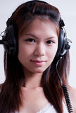Music Girl 2. An image of an asian girl listening to music Stock Images