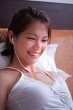 Music Girl 3. An image of an asian girl listening to music Stock Photography
