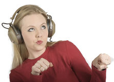 Music Girl. Young woman feeling the groove of the music in her headphones Stock Image