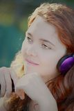 Music girl headphones Royalty Free Stock Images