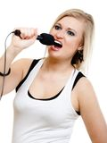 Music. Girl singer musician singing to microphone Stock Images