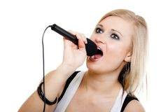 Music. Girl singer musician singing to microphone Stock Photos