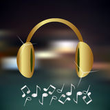 Music gold and shiny headphones icon and background Royalty Free Stock Image