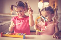 Music is good for all . Little girls at music class. Close up image of two little girls stock image