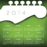 Music Guitar 2014 Calendar. Green 2014 calendar with all months with white electric Fender style guitar headstock and tuners Stock Photos