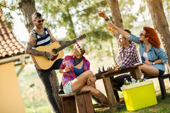 Music, guitar and cold beer makes young people happy Royalty Free Stock Photos