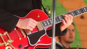 Music guitar concert. Man playing guitar close up on music concert stock footage