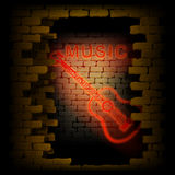 Music and guitar neon light in the doorway of brick wall  Stock Photo