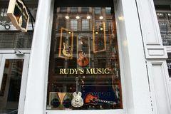 Music guitar shop newyork window. NY visit on sunny day Royalty Free Stock Photos