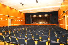 Music Hall with Stage. Music-Hall with rows of blue chairs on the stage instruments ready to be  used Stock Photo