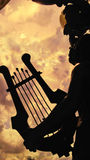 Music from harp under blue sky background Stock Photography