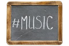 Music hashtag fr. Music hashtag handwritten on vintage school slate board isolated on white Stock Photo