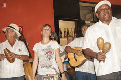 Music in Havana. Havana, Cuba - June 30, 2012: Havana Club musicians performing in the company bar. The band is playing the son Cubano style of music which has stock photo