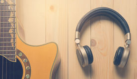 Music Headphone and acoustic guitar for music banner. Music Headphone and acoustic guitar for music banner vintage tone Royalty Free Stock Image