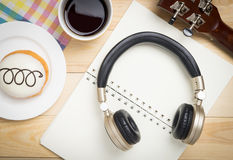 Music Headphone for song writing. In a coffee shop Stock Image