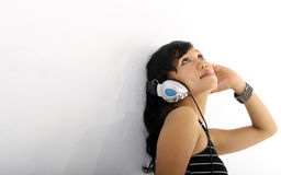 Music and headphones. Portrait of woman smiling listening music on headphones Royalty Free Stock Photos